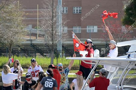 Tampa Bay Buccaneers tight ends Cameron Brate, center, Tanner Hudson, second from right, and Rob Gronkowski, right, acknowledge fans during a celebration of their Super Bowl 55 victory over the Kansas City Chiefs with a boat parade, in Tampa, Fla