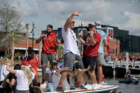 Tampa Bay Buccaneers wide receiver Mike Evans, left, tight end Rob Gronkowski, center, and tight end Tanner Hudson, right, dance while riding in a boat during a celebration of the Buccaneers Super Bowl 55 victory over the Kansas City Chiefs with a boat parade, in Tampa, Fla