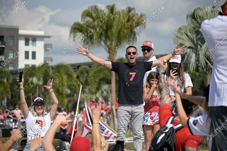 Alex Guerrero (7), personal trainer of Tampa Bay Buccaneers quarterback Tom Brady, cheers during a celebration of their Super Bowl 55 victory over the Kansas City Chiefs with a boat parade, in Tampa, Fla