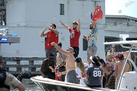 Stock Picture of Tampa Bay Buccaneers receiver Mike Evans, left, and tight ends Rob Gronkowski, center, Tanner Hudson and Cameron Brate, right, wave to fans during a celebration of their Super Bowl 55 victory over the Kansas City Chiefs with a boat parade, in Tampa, Fla