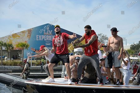Stock Picture of Tampa Bay Buccaneers receiver Mike Evans, center, and tight end Tanner Hudson, left, and receiver Scotty Miller celebrate on a boat during a celebration of their Super Bowl 55 victory over the Kansas City Chiefs with a boat parade, in Tampa, Fla