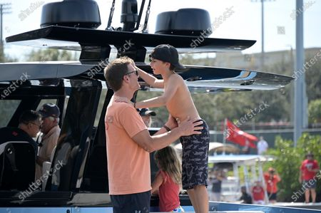 Tampa Bay Buccaneers quarterback Tom Brady and son Benjamin ride on his boat during a celebration of their Super Bowl 55 victory over the Kansas City Chiefs with a boat parade, in Tampa, Fla