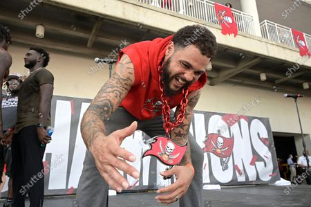 Tampa Bay Buccaneers wide receiver Mike Evans has a laugh during a celebration of their Super Bowl 55 victory over the Kansas City Chiefs after taking part in a boat parade, in Tampa, Fla