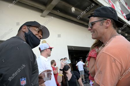 Tampa Bay Buccaneers quarterback Tom Brady, right, talks with offensive coordinator Byron Leftwich during a celebration of their Super Bowl 55 victory over the Kansas City Chiefs after taking part in a boat parade, in Tampa, Fla