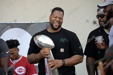 Tampa Bay Buccaneers defensive lineman Ndamukong Suh holds the Vince Lombardi trophy during a celebration of their Super Bowl 55 victory over the Kansas City Chiefs after taking part in a boat parade, in Tampa, Fla