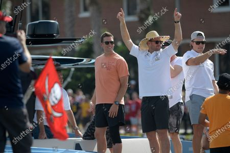 Tampa Bay Buccaneers quarterbacks Tom Brady, left, Blaine Gabbert, right, and Ryan Griffin ride on Brady's boat during a celebration of their Super Bowl 55 victory over the Kansas City Chiefs with a boat parade, in Tampa, Fla