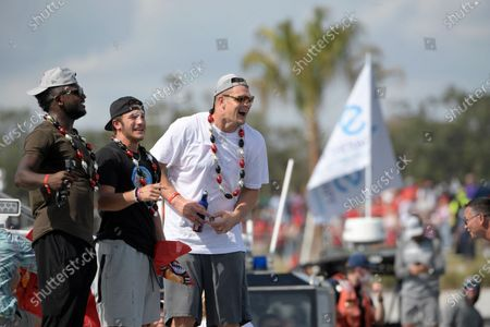 Tampa Bay Buccaneers receivers Chris Godwin, left, and Scotty Miller, center, and tight end Rob Gronkowski celebrate on a boat during a celebration of their Super Bowl 55 victory over the Kansas City Chiefs with a boat parade, in Tampa, Fla