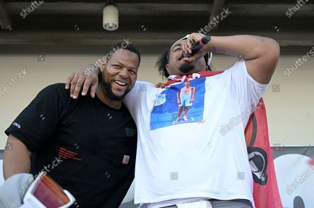 Stock Picture of Tampa Bay Buccaneers defensive linemen Ndamukong Suh, left, and Vita Vea address the audience during a celebration of their Super Bowl 55 victory over the Kansas City Chiefs after taking part in a boat parade, in Tampa, Fla