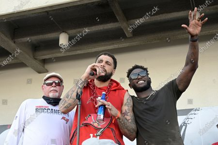 Stock Image of Tampa Bay Buccaneers head coach Bruce Arians, left, and wide receivers Mike Evans (13) and Chris Godwin address the audience during a celebration of their Super Bowl 55 victory over the Kansas City Chiefs after taking part in a boat parade, in Tampa, Fla