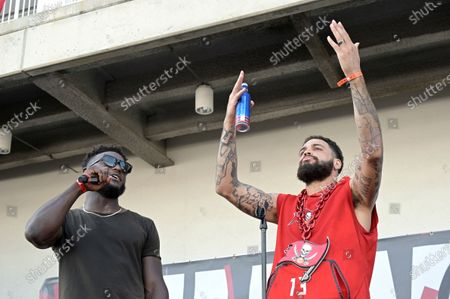 Stock Photo of Tampa Bay Buccaneers wide receivers Mike Evans (13) and Chris Godwin address the audience during a celebration of their Super Bowl 55 victory over the Kansas City Chiefs after taking part in a boat parade, in Tampa, Fla