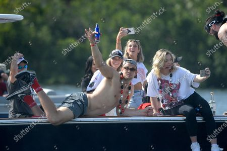 Tampa Bay Buccaneers tight end Rob Gronkowski waves from a boat during a celebration of their Super Bowl 55 victory over the Kansas City Chiefs with a boat parade, in Tampa, Fla