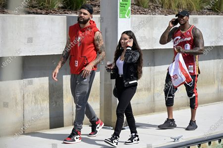 Tampa Bay Buccaneers receiver Mike Evans (13) and his wife Ashli Evans, center, arrive for a celebration of their Super Bowl 55 victory over the Kansas City Chiefs with a boat parade, in Tampa, Fla