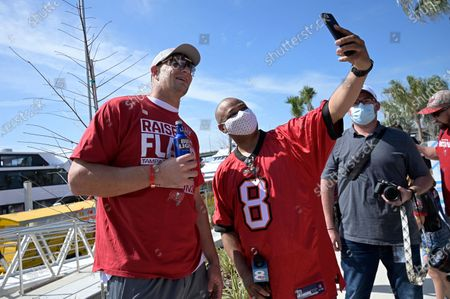 Tampa Bay Buccaneers tight end Rob Gronkowski, left, poses with a member of the media before a celebration of their Super Bowl 55 victory over the Kansas City Chiefs with a boat parade, in Tampa, Fla