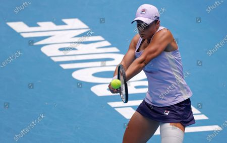 Australia's Ash Barty makes a backhand return to compatriot Daria Gavrilova during their second round match at the Australian Open tennis championship in Melbourne, Australia