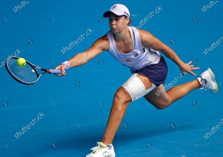 Australia's Ash Barty makes a forehand return to compatriot Daria Gavrilova during their second round match at the Australian Open tennis championship in Melbourne, Australia