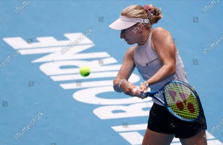 Australia's Daria Gavrilova makes a backhand return to compatriot Ash Barty during their second round match at the Australian Open tennis championship in Melbourne, Australia