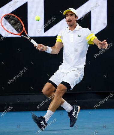 Uruguay's Pablo Cuevas makes a forehand return to Australia's Alex De Minaur during their second round match at the Australian Open tennis championship in Melbourne, Australia