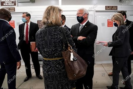 Sen. Roger Wicker (R-Miss.) speaks to Sen. Cynthia Lummis (R-Wyo.) as they leave the Capitol for a dinner break during the second day of the impeachment trial of former President Donald Trump