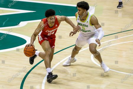 Houston's Quentin Grimes, left, drives past South Florida's David Collins during the first half of an NCAA college basketball game, in Tampa, Fla