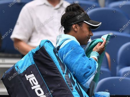 Heather Watson leaving the court after losing her second round match