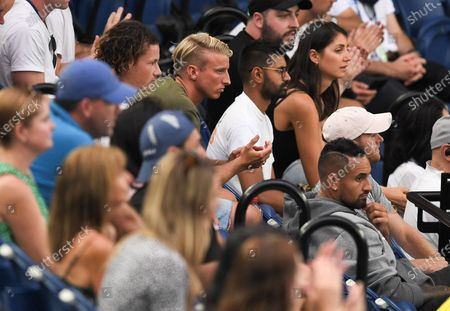 Nick Kyrgios watching the second round match between Stefanos Tsitsipas and Thanasi Kokkinakis from the stands