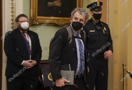 Senator Sherrod Brown (D-OH) walks through the U.S. Capitol building in Washington, D.C.. House Democrats utilized video from the January 6th attack on the U.S. Capitol during today's impeachment trial, yet a lack GOP votes are likely to impede a conviction of Former President Donald Trump.
