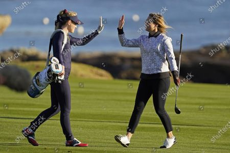 Kira K. Dixon, right, is greeted by playing partner Kathryn Newton on the 18th fairway during the charity challenge event of the AT&T Pebble Beach Pro-Am golf tournament, in Pebble Beach, Calif