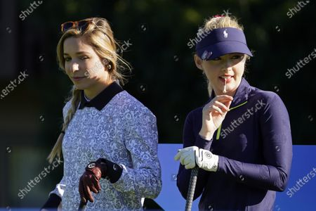 Kira K. Dixon, left, and Kathryn Newton wait to hit from the first tee during the charity challenge event of the AT&T Pebble Beach Pro-Am golf tournament, in Pebble Beach, Calif