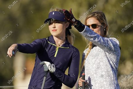 Kathryn Newton, left, and Kira K. Dixon prepare to hit from the third tee during the charity challenge event of the AT&T Pebble Beach Pro-Am golf tournament, in Pebble Beach, Calif