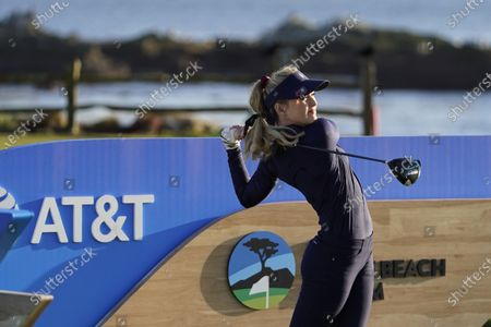 Kathryn Newton follows her drive from the 18th tee during the charity challenge event of the AT&T Pebble Beach Pro-Am golf tournament, in Pebble Beach, Calif
