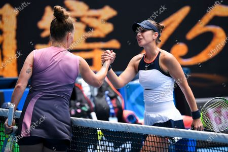 Belinda Bencic of Switzerland (R) is congratulated by Svetlana Kuznetsova of Russia (L) after winning their second round tennis match of the Australian Open Grand Slam tennis tournament at Melbourne Park in Melbourne, Australia, 11 February 2021.