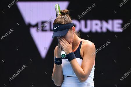Belinda Bencic of Switzerland celebrates after winning her second Round Women's singles match against Svetlana Kuznetsova of Russia on Day 4 of the Australian Open Grand Slam tennis tournament at Melbourne Park in Melbourne, Australia, 11 February 2021.