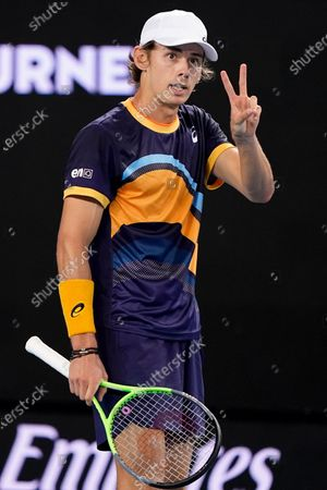 Alex de Minaur of Australia gestures during his second Round Men's singles match against Pablo Cuevas of Uruguay on Day 4 of the Australian Open Grand Slam tennis tournament at Melbourne Park in Melbourne, Australia, 11 February 2021.