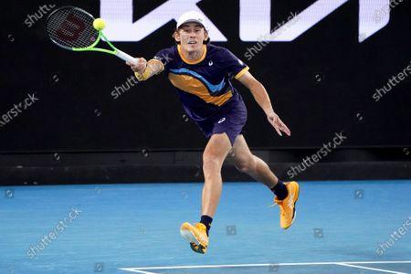 Alex de Minaur of Australia in action during his second Round Men's singles match against Pablo Cuevas of Uruguay on Day 4 of the Australian Open Grand Slam tennis tournament at Melbourne Park in Melbourne, Australia, 11 February 2021.
