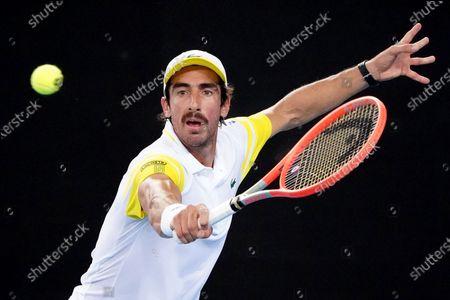 Pablo Cuevas of Uruguay in action during his second Round Men's singles match against Alex de Minaur of Australia on Day 4 of the Australian Open Grand Slam tennis tournament at Melbourne Park in Melbourne, Australia, 11 February 2021.