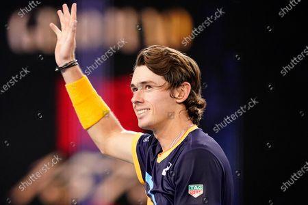 Alex de Minaur of Australia gestures after winning his second Round Men's singles match against Pablo Cuevas of Uruguay on Day 4 of the Australian Open Grand Slam tennis tournament at Melbourne Park in Melbourne, Australia, 11 February 2021.