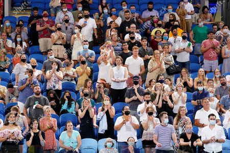 Stock Photo of Spectators are seen in the crowd during the second Round Men's singles match between Alex de Minaur of Australia and Pablo Cuevas of Uruguay on Day 4 of the Australian Open Grand Slam tennis tournament at Melbourne Park in Melbourne, Australia, 11 February 2021.