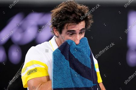 Pablo Cuevas of Uruguay leaves the court following his loss to Alex de Minaur of Australia in the second Round Men's singles match on Day 4 of the Australian Open Grand Slam tennis tournament at Melbourne Park in Melbourne, Australia, 11 February 2021.