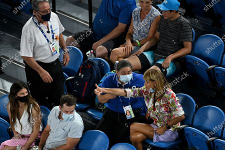 A spectator is removed from Rod Laver Arena during the second Round Men's singles match between Rafael Nadal of Spain and Michael Mmoh of the USA on Day 4 of the Australian Open at Melbourne Park in Melbourne, Australia, 11 February 2021.
