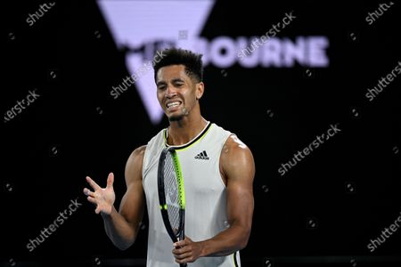 Michael Mmoh of the USA reacts during his second Round Men's singles match against Rafael Nadal of Spain on Day 4 of the Australian Open at Melbourne Park in Melbourne, Australia, 11 February 2021.