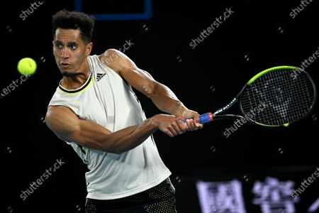 Michael Mmoh of the USA in action during his second Round Men's singles match against Rafael Nadal of Spain on Day 4 of the Australian Open at Melbourne Park in Melbourne, Australia, 11 February 2021.