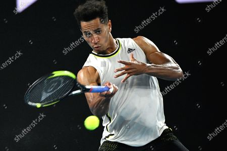 Michael Mmoh of the USA in action during his men's singles second round match against Rafael Nadal of Spain at the Australian Open Grand Slam tennis tournament at Melbourne Park in Melbourne, Australia, 11 February 2021.