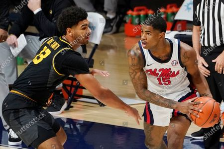 Missouri guard Mark Smith (13) defends against Mississippi guard Luis Rodriguez (15) during the first half of an NCAA college basketball game in Oxford, Miss