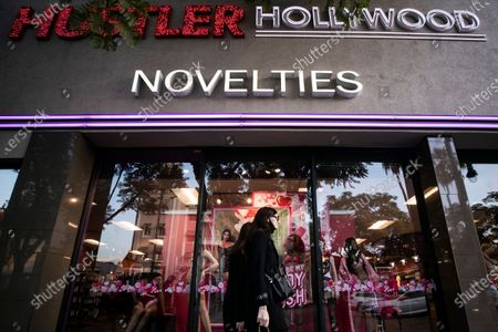 A pedestrian walks past Larry Flynt's Hustler shop in Hollywood, California, USA, 10 February 2021. Larry Flynt, founder of Hustler magazine, died on 10 February 2021 at the age of 78.