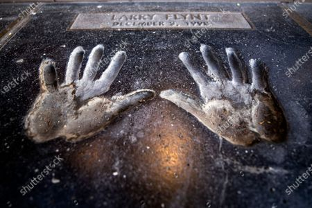 Stock Picture of Larry Flynt's handprints are photographed in front of his Hustler shop in Hollywood, California, USA, 10 February 2021. Larry Flynt, founder of Hustler magazine, died on 10 February 2021 at the age of 78.
