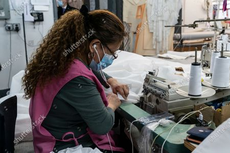 LG Kathy Hochul visits Four Seasons Fashion as part of women-owned nonprofit Garment District for Gowns on 39th street of Manhattan. LG was touring Four Season Fashion company owned by Tony Singh (not pictured). On this photo semastress seen sewing PPE. Nonprofit organization helped already to manufacture more than 300,000 PPE and sent them to New York State hospitals.