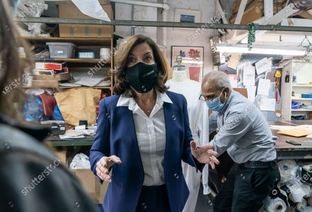 Stock Image of LG Kathy Hochul visits Four Seasons Fashion as part of women-owned nonprofit Garment District for Gowns on 39th street of Manhattan. LG was touring Four Season Fashion company owned by Tony Singh (at the back). Nonprofit organization helped already to manufacture more than 300,000 PPE and sent them to New York State hospitals.