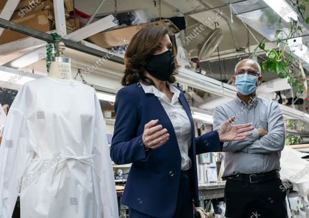 Stock Picture of LG Kathy Hochul visits Four Seasons Fashion as part of women-owned nonprofit Garment District for Gowns on 39th street of Manhattan. LG was touring Four Season Fashion company owned by Tony Singh (R). Nonprofit organization helped already to manufacture more than 300,000 PPE and sent them to New York State hospitals.