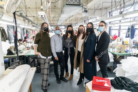 LG Kathy Hochul visits Four Seasons Fashion as part of women-owned nonprofit Garment District for Gowns on 39th street of Manhattan. LG was touring Four Season Fashion company owned by Tony Singh (2nd from left) and presented by women who started nonprofit Garment District for Gowns Amy Tiefermann (1st from left), (to the left from Tony) Rachel Rothenberg, Alexandra Baylis, Alessandra Dean and Emmanuel Nunez. Nonprofit organization helped already to manufacture more than 300,000 PPE and sent them to New York State hospitals.