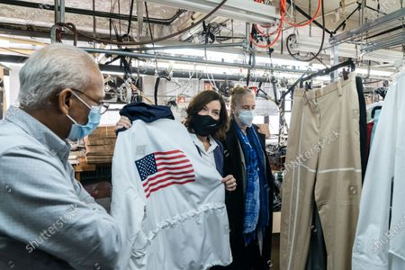 LG Kathy Hochul visits Four Seasons Fashion as part of women-owned nonprofit Garment District for Gowns on 39th street of Manhattan. LG was touring Four Season Fashion company owned by Tony Singh (R) and joined by Manhattan borough President Gail Brewer. Nonprofit organization helped already to manufacture more than 300,000 PPE and sent them to New York State hospitals. On this photo Tony showed up garment for US athlets to be weared at Tokyo Summer Olympics designed by Ralph Laurent and manufactured at Four Season Fashion prior to pandemic started.